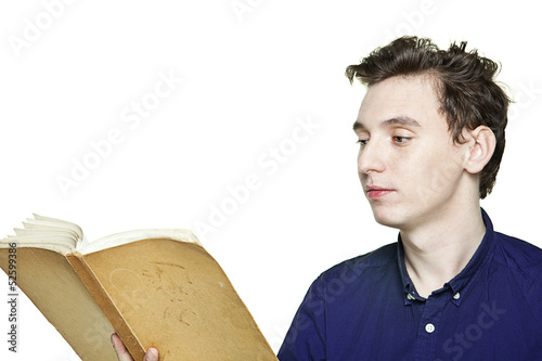 young handsome boy reads a book