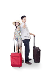 Asian couple bring luggage on white