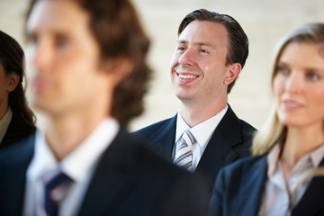 Businessman Listening To Speaker At Conference