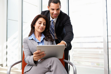 Businesspeople With Digital Tablet During Informal Meeting