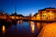 ships on canal in Groningen at night