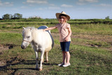 child little cowboy and pony horse