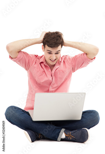 Young man having problem with his laptop