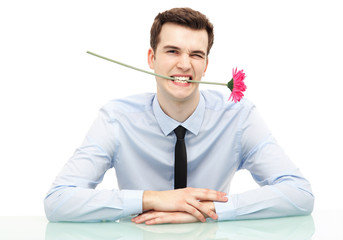 Businessman biting flower