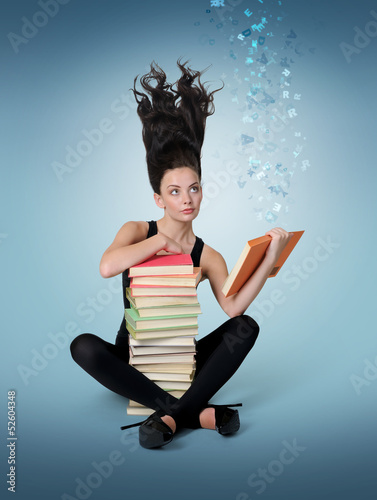 Dreamy young girl reading a book, concept of fantasy