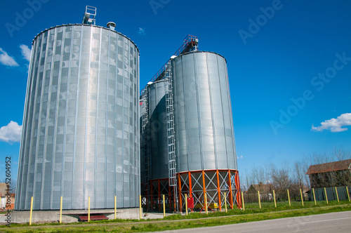 Silver Grain Silos with blue sky in background