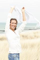 Woman enjoying sea breeze