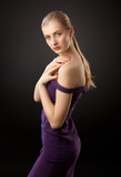 blonde girl in purple dress