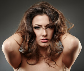 Beautiful woman posing with hands in her hair