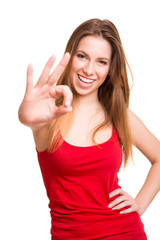 Attractive woman doing OK sign