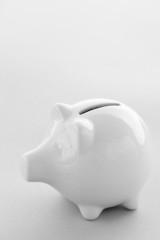 White Piggy Bank On Blue Background