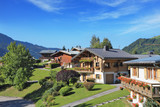 Green alpine meadows and chalets.