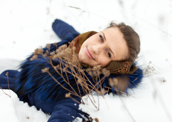 woman lying in coat on the  snow