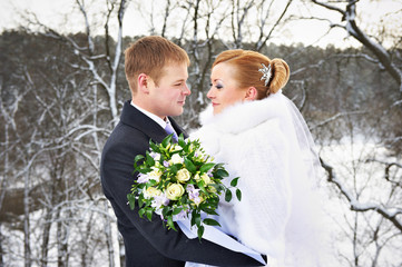 Happy bride and groom on winter wedding day