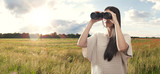 Young woman watching with binocular