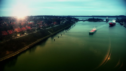 Cargo ships at sunset in Kiel Canal, Germany, time lapse