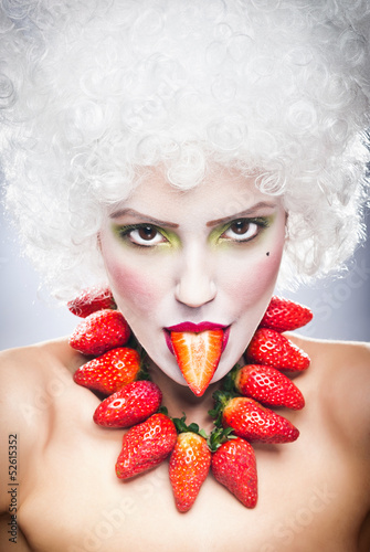 Creative makeup beauty shot of model with strawberries,artistic
