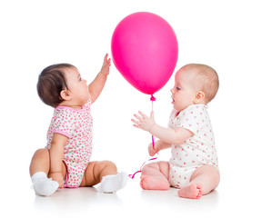 babies girls play red ballon isolated on white