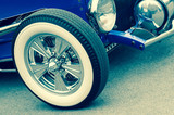 retro toned luxury vintage auto with white-wall wheels