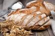 Fresh bread on wooden ground