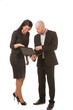 Businesswoman and businessman looking at laptop