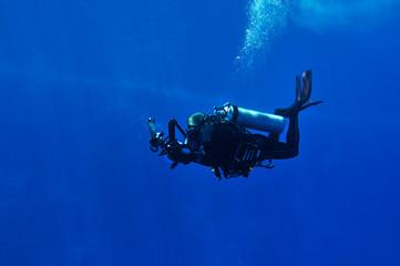 Diver taking photo underwater
