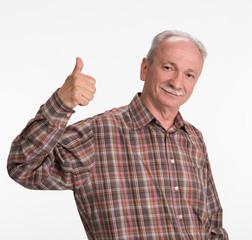 Elderlyl man shows ok sigh