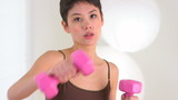 Chinese woman punching while holding weights