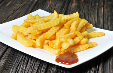 A Serving of fries with barbecue sauce