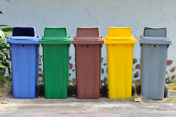 Different color of garbage bin.