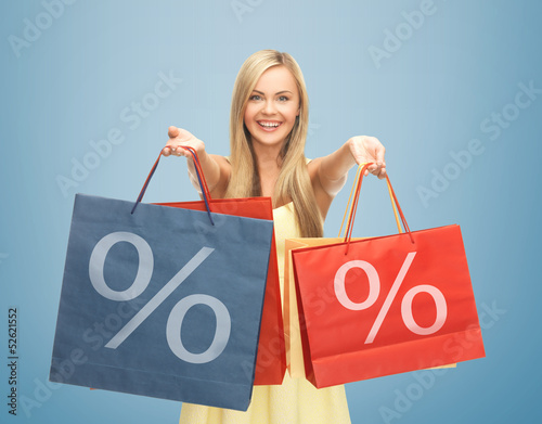 woman holding shopping bags with percent sign