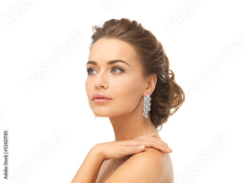 woman wearing shiny diamond earrings