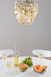 Decorative chandelier and table setting with wine