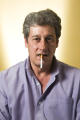man with a cigarette in his mouth