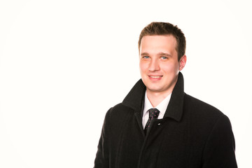 Handsome young businessman in a coat  isolated