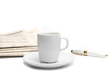 coffee near financial newspaper and pen