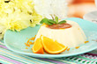 Panna Cotta with orange zest and caramel sauce,