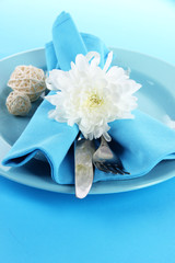 Served plate with napkin and flowers close-up