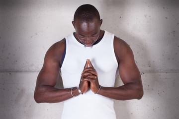 A black man praying
