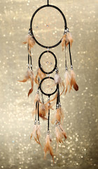 Beautiful dream catcher on background with lights