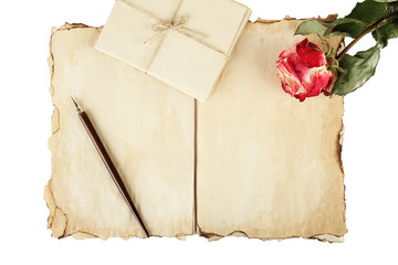 Old paper, letters and rose isolated on white
