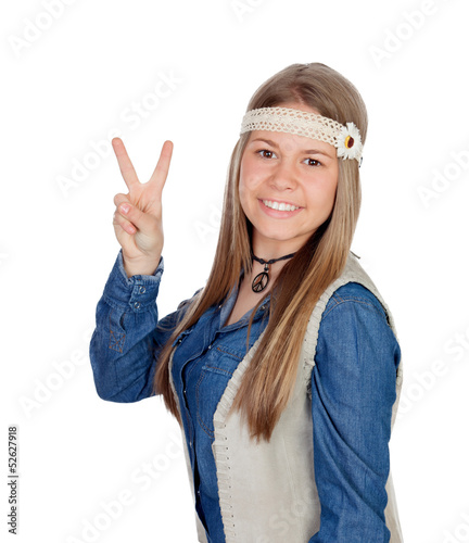 Pretty girl with hippie clothes making the peace symbol