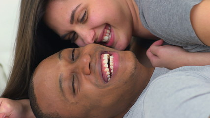 Portrait of happy young African American and Caucasian couple