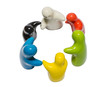 Abstract image of ceramic dolls in different color hands togethe