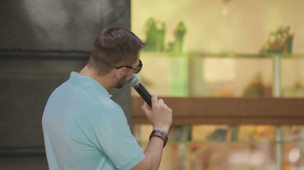 man speaks into a microphone
