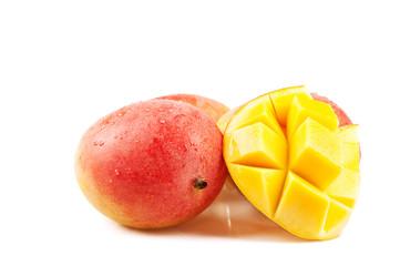 close up of a mango cut in a crisscross pattern