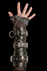 Hand in Leather Cuffs on Black