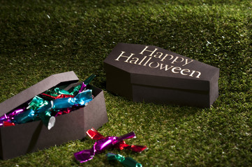 Halloween coffin on lawn with sweets