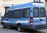Armored van of the Italian police involved in a checkpoint in a poster