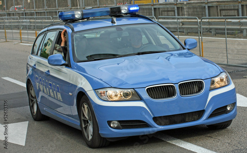 fast Italian police car runs fast on the way to a total emergenc